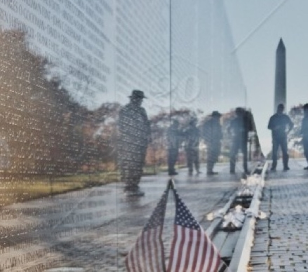 Washington DC Vietnam wall with names and American Flag with Washington Monument in background