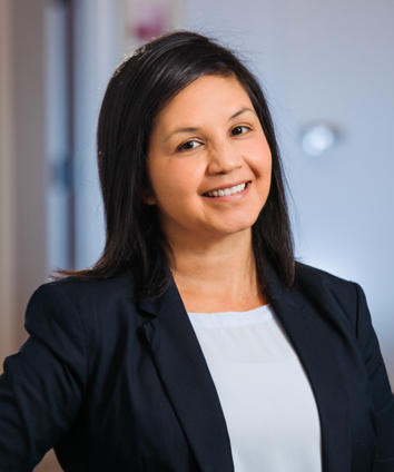 Sandra Valiente Smiling Team Headshot with hand on hip